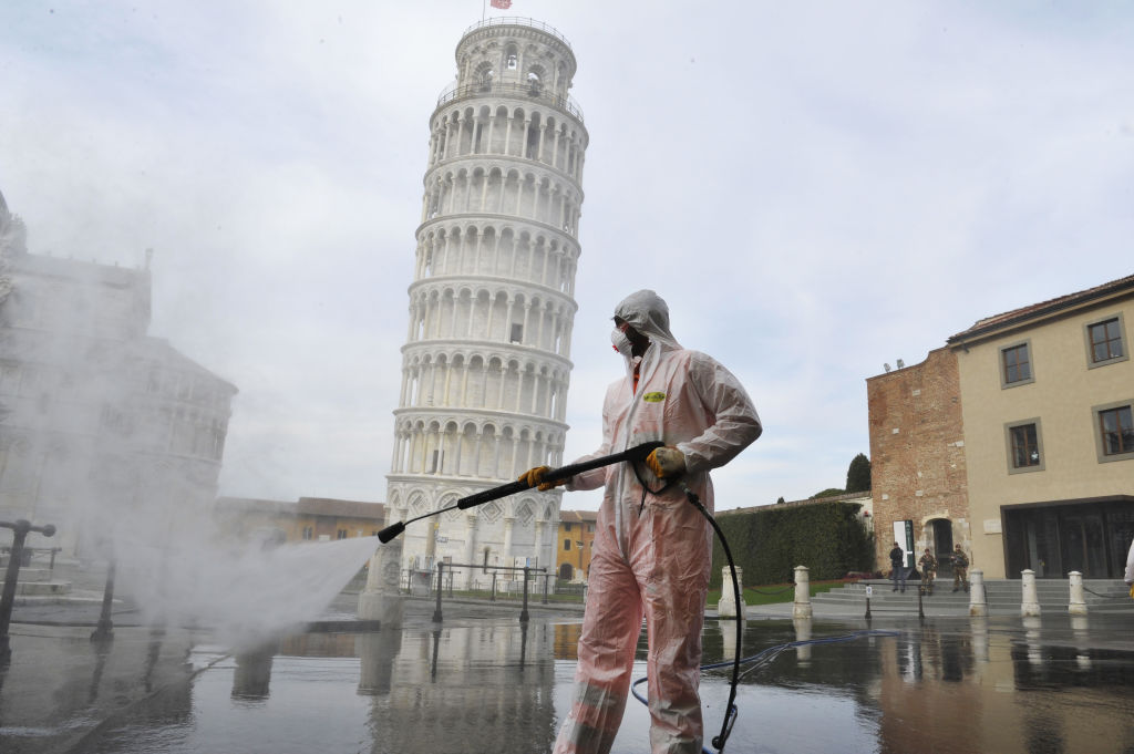 Cleaning the plaza of the Leaning Tower of Pisa